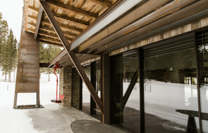 Exposed Exterior Structural Steel And Outdoor Fireplace Chimney. Raw Finish.