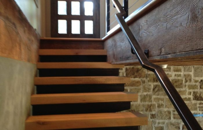Wood Treads Over Cantilevered Steel Supports. Steel Grabrail. Black Wax Finish.